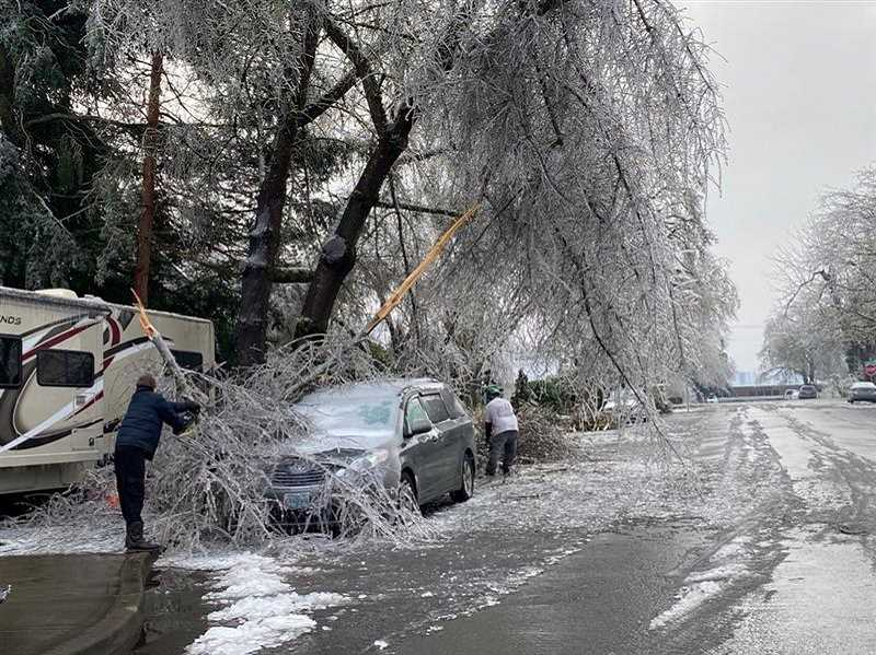 PMG PHOTO: SANDY STOREY - The icy scene in Molalla required plenty of neighborly help as the city battled to keep wastewater and water treatment plant going.