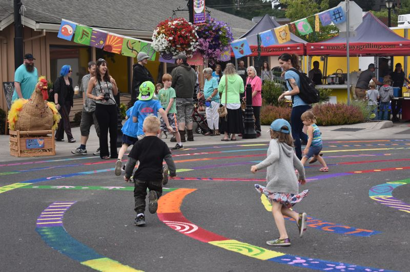 PMG FILE PHOTO - Attendees of the 2019 Summer Celebration enjoy the event's colorful labrynth.