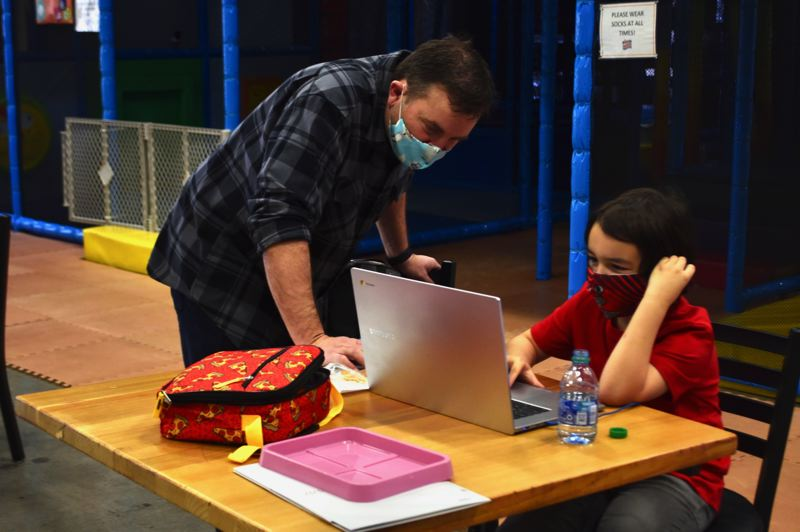 PMG FILE PHOTO: BRITTANY ALLEN - Hans Wipper helps a student in one of Wippersnapper's distance learning camps.