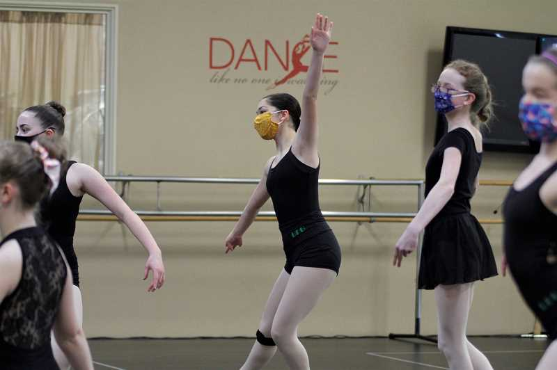 """PMG PHOTO: WADE EVANSON - Makenna Marshall, Mary Crosby and MacKenzi Clark practice for the upcoming """"Nutcracker"""" production at the Forest Grove Dance Arts studio. The studio was able to again open to students as a result of the state's new COVID-19 guidelines."""