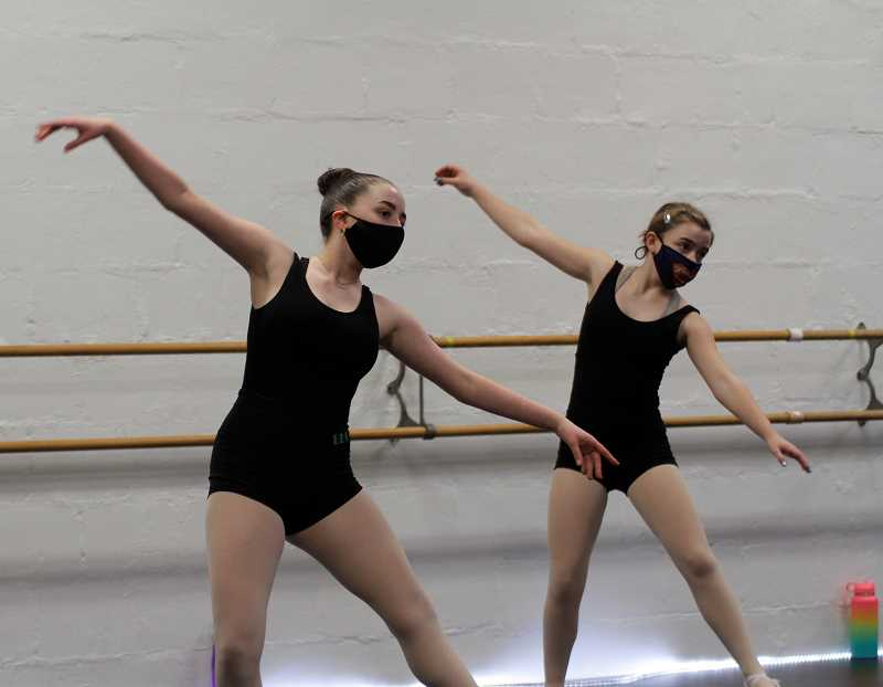 """PMG PHOTO: WADE EVANSON - Violet Siebert (left) and Brenna Colfelt (right) practice for the upcoming """"Nutcracker"""" production at the Forest Grove Dance Arts studio. The studio was able to again open to students as a result of the state's new COVID-19 guidelines."""