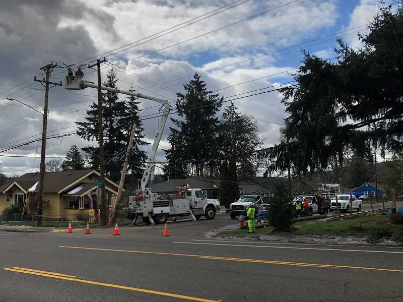 COURTESY PHOTO: KOIN 6 NEWS - Crews work to restore power in Gladstone after the storm knocked down several power poles near Oatfield Road and Hereford Street.