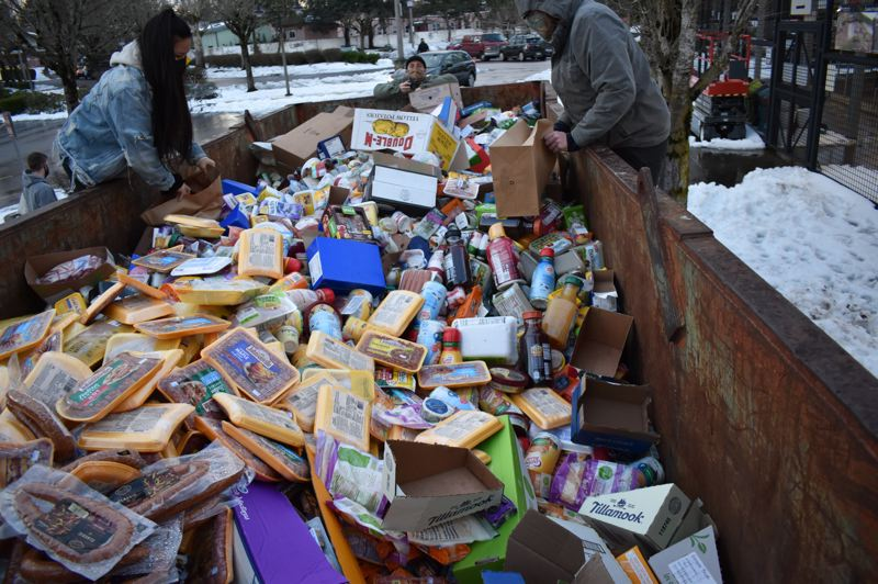 COURTESY PHOTO: J.L. SIMONIS - Residents surveyed a dumpster full of discarded food outside a Northeast Portland Fred Meyer on Tuesday, Feb. 16.