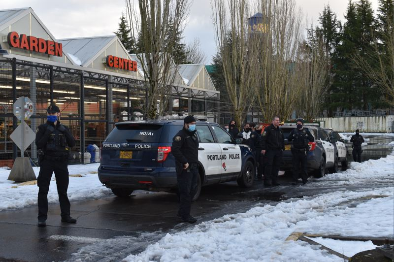 COURTESY PHOTO: J.L. SIMONIS - Portland Police Bureau officers stood guard outside a Northeast Portland Fred Meyer after store employees said groups of dumpster divers were trespassing.