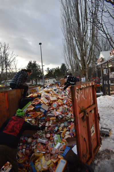 COURTESY PHOTO: J.L. SIMONIS - Portlanders surveyed the contents of a dumpster packed with food at the Hollywood West Fred Meyer.
