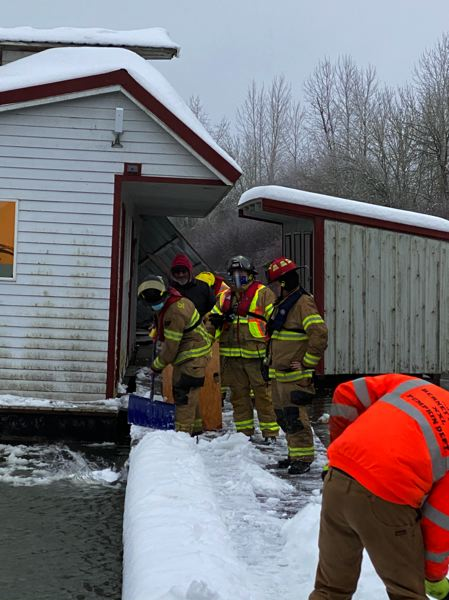 COURTESY PHOTO: SCAPPOOSE FIRE DISTRICT - Firefighters shovel snow off a dock at Scappoose Moorage.