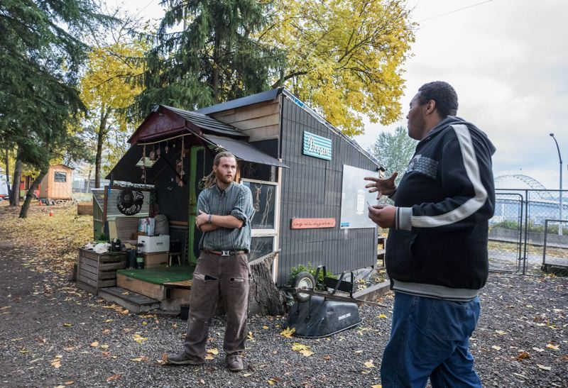 FILE PHOTO - Hazelnut Grove residents Tequila Gordon, left and Bob Brimmer chat in the small village in 2017.