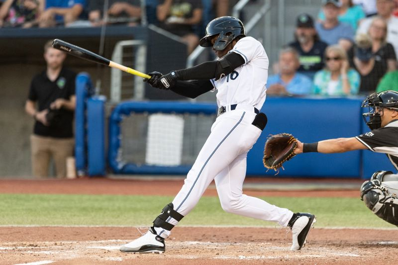 PMG FILE PHOTO - Hillsboro Hops outfielder Kristian Robinson hits during a 2019 game. Robinson, one of MLB.com's top-ranked prospects this year, could be back in Hillsboro as a High-A player this season.