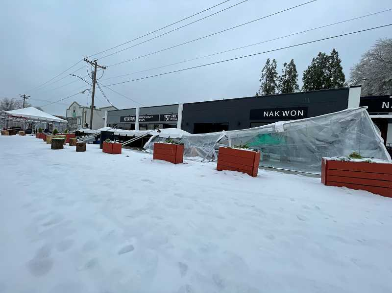 COURTESY PHOTO: BEN REESE - Tents caved in at the 1st Street Dining Commons in Beaverton. A large tent was rendered a complete loss due to the icy conditions, according to Ben Reese, who owns a coffee shop nearby.