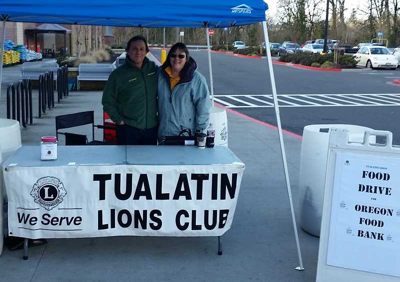 COURTESY PHOTO: TUALATIN LIONS CLUB - Tualatin Lions Mark Willon and Jackie Dannemiller collect canned food donations at the 2020 Super Saturday Food Drive sponsored by the Tualatin Lions Club. Because of COVID-19 concerns, no actually food can be collected this year. However, cash or check donations will be gladly accepted.