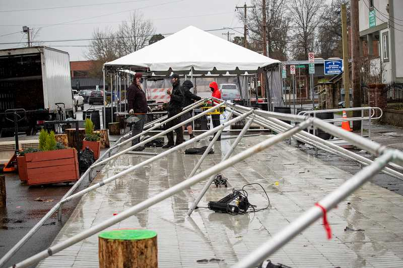 PMG PHOTO: JAIME VALDEZ - A work crew from Portland Productions set up tents at the First Street Dining Commons on Thursday, Feb. 18.
