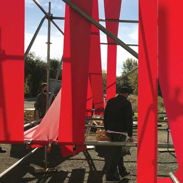 COURTESY PHOTO: DAVID BUCKLEY BORDEN - Artist David Buckley Borden and his crew test the fabric on his Universal Beacon installation recently. Plans are to complete the project this week at Universal Plaza.