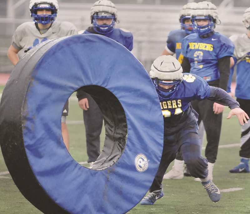 PMG PHOTO: GARY ALLEN - Newberg returns eight starters on both offense and defense this year.