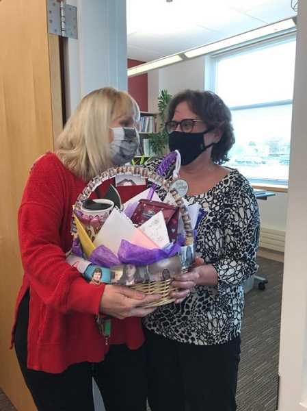 COURTESY PHOTO - Baker Prairie Middle School teacher Brooke Cates (left) delivers a basket of goodies and notes from her and her students to Principal Jennifer Turner.