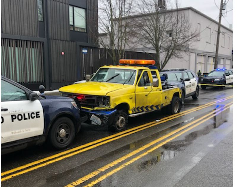 COURTESY PHOTO: PORTLAND POLICE BUREAU - This tow truck is boxed in Portland police after several hit-and-run crashes on Thursday, Feb. 18.