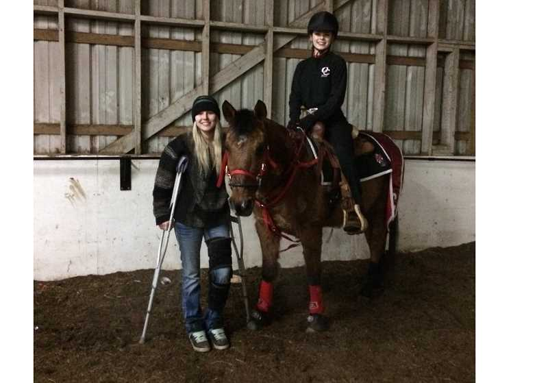 COURTESY PHOTO - An injured Ashley Maestas attends an Oregon City High School equestrian event to support former teammate Grace Steiner.