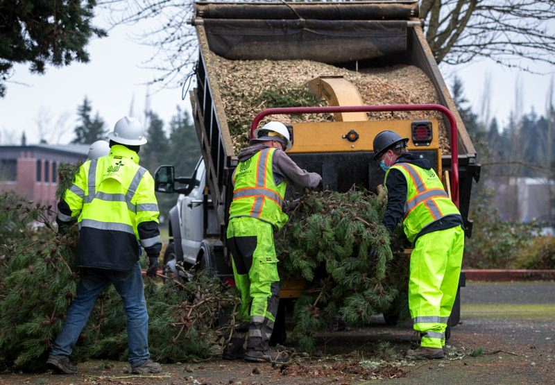 PMG PHOTO: JAIME VALDEZ - Wilsonville employees clean up branches and other debris at the Clackamas Community College campus.