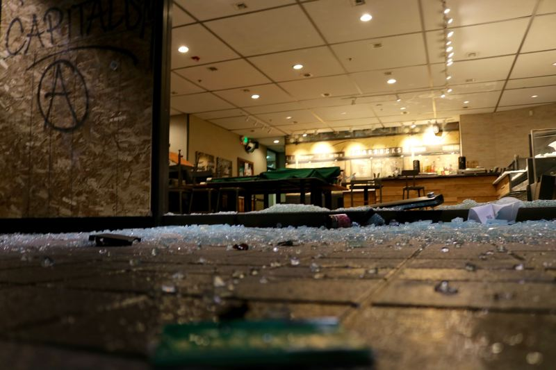 PMG PHOTO: ZANE SPARLING - Broken glass and building damage mar a Starbucks inside the Standard Insurance building in downtown Portland on Jan 1.
