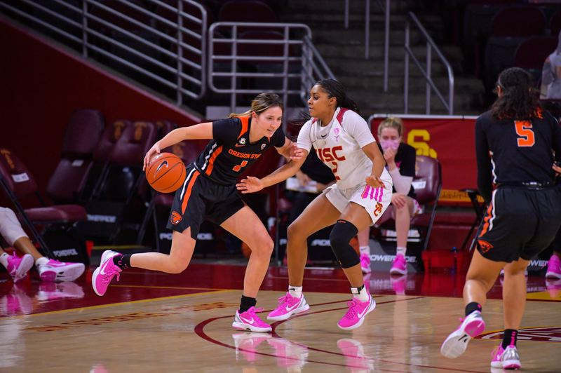 COURTESY PHOTO: JOHN MCGILLEN - Oregon State's Aleah Goodman is defender by USC's Desiree Caldwell during the Beavers' Feb. 19 win in Los Angeles.