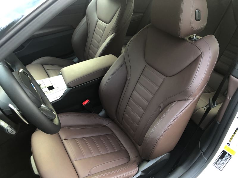 PMG PHOTO: JEFF ZURSCHMEIDE - The supple 'Mocha Vernasca' leather upholstery covers heated sport seats and the heated steering wheel that comes as part of the Premium option package.