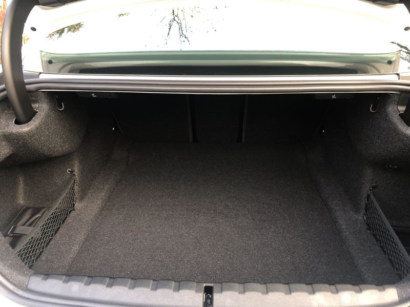 PMG PHOTO: JEFF ZURSCHMEIDE - Trunk space in the 2021 BMW 430I is more than reasonable for a compact coupe.