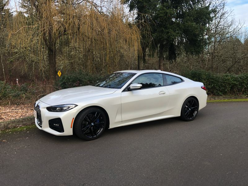 PMG PHOTO: JEFF ZURSCHMEIDE - Given the nose, the rest of the lines of the 2021 BMW 430i Coupe are remarkably restrained.