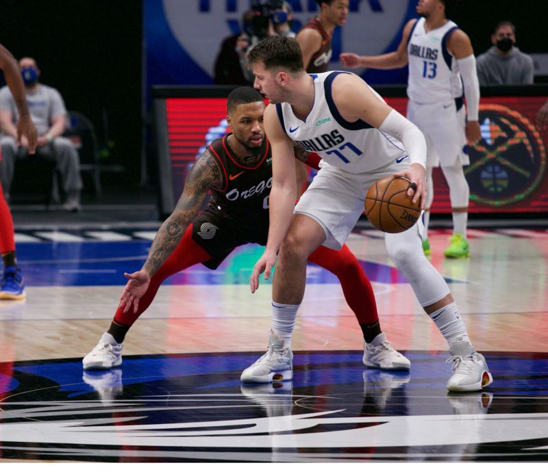 COURTESY PHOTO: BRUCE ELY/TRAIL BLAZERS - Damian Lillard finished third among Western Conference guards for two starting spots in the upcoming NBA All-Star Game. Luka Doncic, guarded by Lillard in this photo, was second.