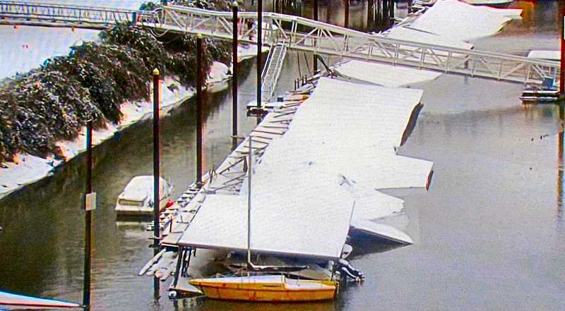 COURTESY KATU-2 TV NEWS - The extent of the structural collapse of the Portland Rowing Club boat shelter onto the boats - beneath, in their slips - at the Sellwood Marina was evident in this view from the south side of the Sellwood Bridge.