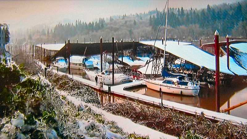 COURTESY KPTV FOX-12 NEWS - Then, on Monday morning, February 15, after another overnight ice storm and just before the thawing began, the latest ice brought down another boat awning - at the adjacent Waverly Marina - damaging more watercraft. Again, first-responders arrived to mitigate the damage.