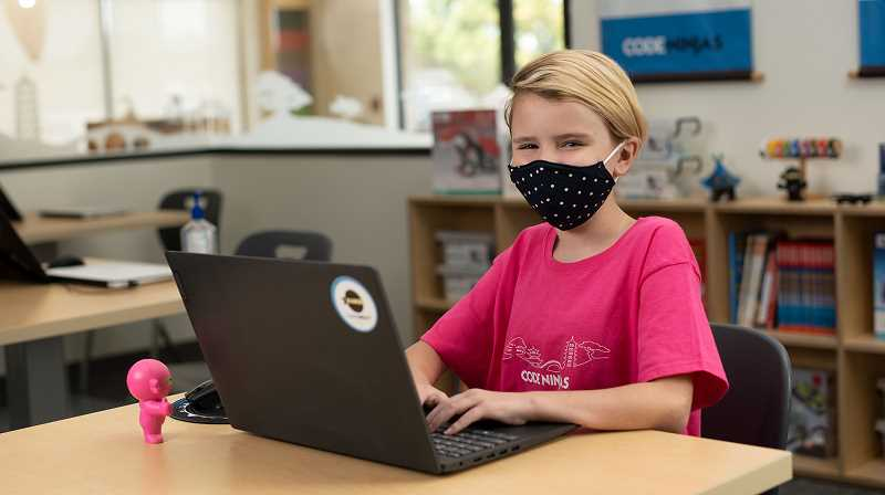 COURTESY PHOTO: CODE NINJAS - A child learning how to code while wearing a mask due to COVID-19 guidelines. Code Ninjas in Bethany offers in-person and remote programs.