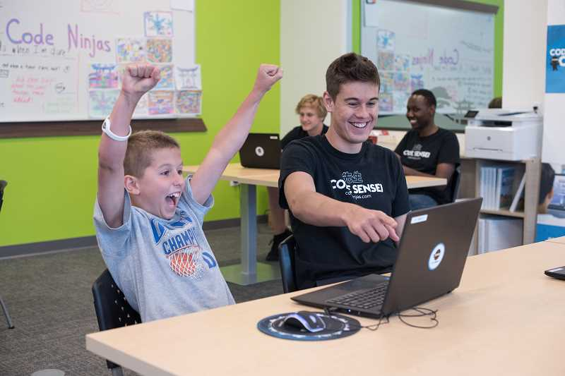 COURTESY PHOTO: CODE NINJAS - A boy celebrates while working on a program with Code Ninjas. The business teaches kids how to code in fun ways, such as creating their own video game to spark interest.