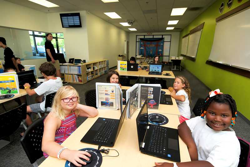 COURTESY PHOTO: CODE NINJAS - Girls learning how to code at Code Ninjas. The learning center offers classes, camps and various programs for kids wanting to learn how to code.