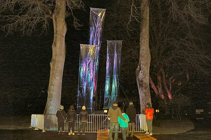 DAVID F. ASHTON - Visitors stood in awe, taking in the shimmering lights reflected at the Kaleidoscopic Canopy installation at Oaks Amusement Park, as part of the 2021 Portland Winter Light (non)Festival.