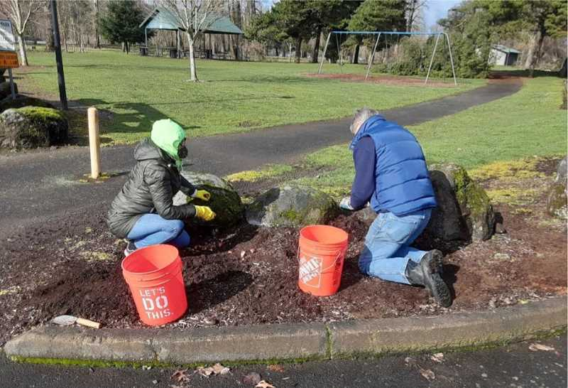 COURTESY PHOTO: AIDAN MCNIECE  - County Clerk Sherry Hall and State Sen. Bill Kennemer plant bulbs on Feb. 20 in Oregon City.