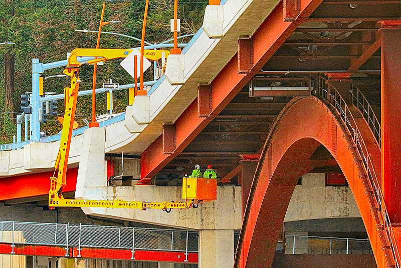 DAVID F. ASHTON - Riding in the gondola of a specially-built personnel lift dangling off the side of the Sellwood Bridge, independent inspectors returned to take another close look at the superstructure.
