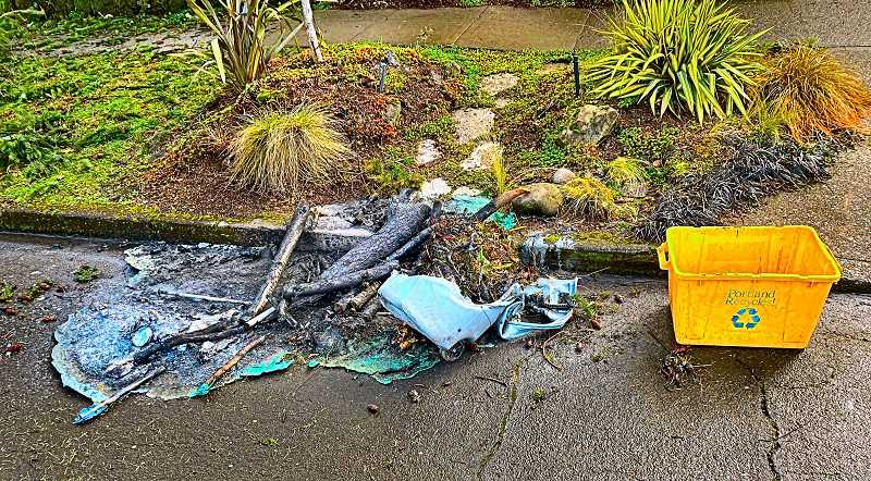 This was what was left, after three large recycling bins left at the curb in Woodstock were burned by an arsonist in the early morning hours of February 20.