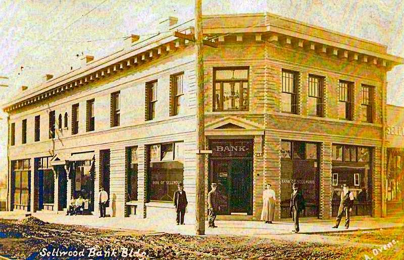 COURTESY STEPHEN KINNEY COLLECTION, PDXHISTORY.COM - These are 1909 Bank of Sellwood customers. The Bank was considered a stunning work of art, since most buildings built along 13th Avenue at the time were made of wood, were one dimensional, and were usually only one-story structures. Notice the dirt streets! The Sellwood Barber Shop to the left of the Bank entrance opened in 1907, the same year the Bank of Sellwood was built.