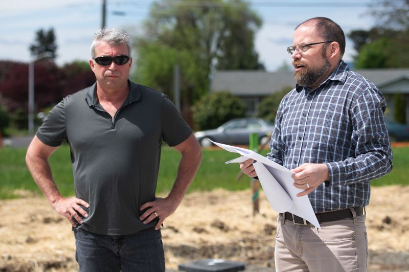 PMG FILE PHOTO: - Ryan Wells, right, at the Emmerts River West development in Cornelius in May 2018.