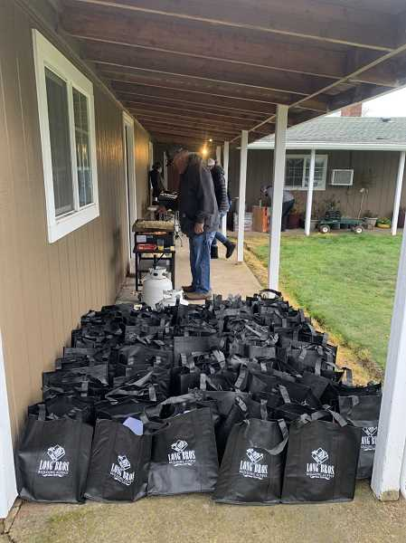 COURTESY PHOTO: NICHOLE HETLAND - A group of Woodburn-area volunteers cooked breakfast and assembled to-go bag lunches for area crews working to repair winter-storm damaged infrastructure.