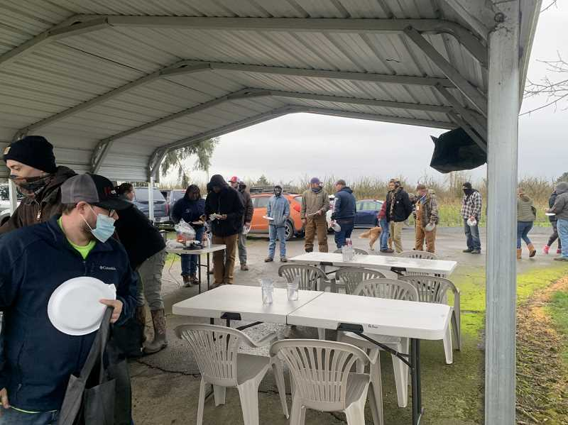 COURTESY PHOTO: NICHOLE HETLAND - Out-of-state workers who came to help swamped utility workers following the winter storms were treated to a Sunday morning breakfast by Woodburn-area volunteers.