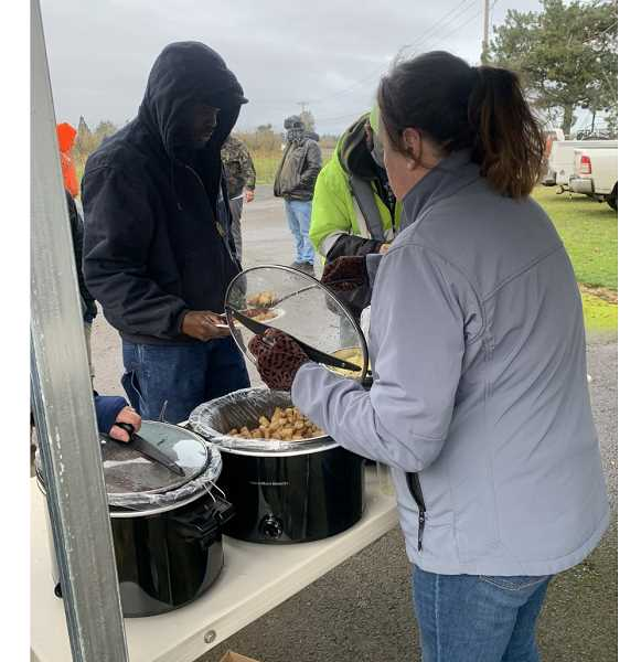 COURTESY PHOTO: NICHOLE HETLAND - Volunteers cooked and served a Sunday morning breakfast near Woodburn to show appreciation for the crews working to restore infrastructure damaged by winter storms.