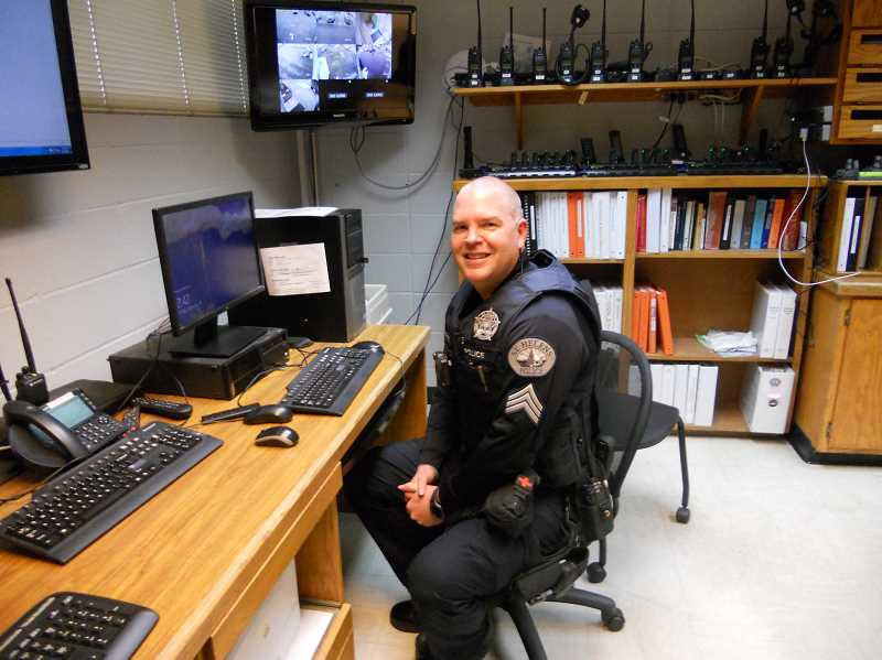 PMG PHOTO: SCOTT KEITH - Sgt. Evin Eustice relaxes in the St. Helens Police Department briefing room.