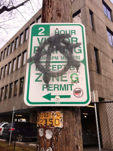 PMG PHOTO: ZANE SPARLING - An anarchist symbol was spraypainted on a Portland parking sign during a protest on Jan. 20.
