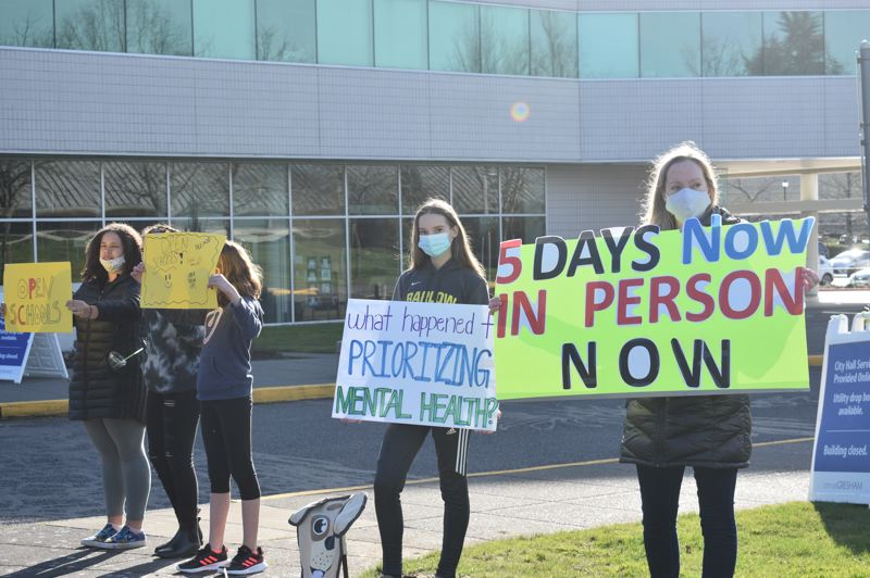 Students and parents rally to re-open schools