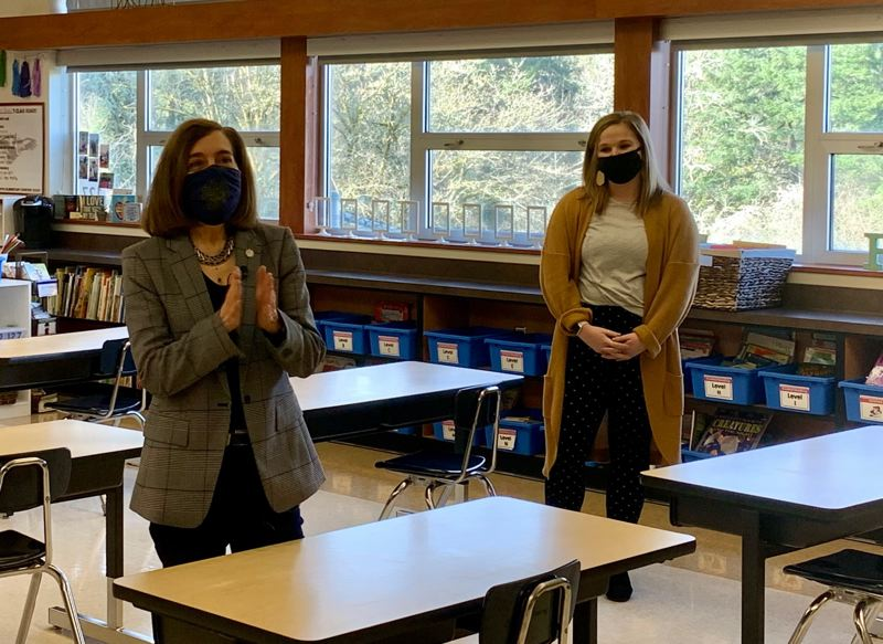 POOL PHOTO: SALEM STATESMAN JOURNAL - Oregon Gov. Kate Brown visited a West Salem school Wednesday morning, Feb. 24. State economists said tax collections were still going well despite a pandemic shutdown of large sections of the state economy.