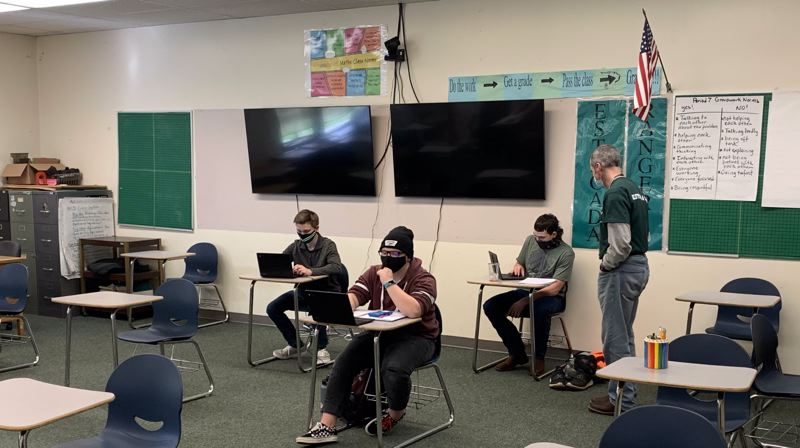 COURTESY PHOTO: ESTACADA SCHOOL DISTRICT - A small group of Estacada High School students work in a classroom as the school moves to hybrid learning.