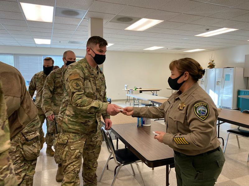 COURTESY PHOTO - CLACKAMAS COUNTY SHERIFF'S OFFICE - Sheriff Angela Brandenburg interacts with Oregon National Guard members deployed to help CCSO respond to the ice storm by performing wellness checks in the local community.