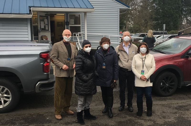 PHOTO COURTESY OF CLACKAMAS COUNTY - From left: Clackamas County Commissioners Mark Shull, Sonya Fischer, Chair Tootie Smith, Paul Savas and Martha Schrader pose for a photo while out in the community responding to the ice storm that hit the county Valentines Day weekend.