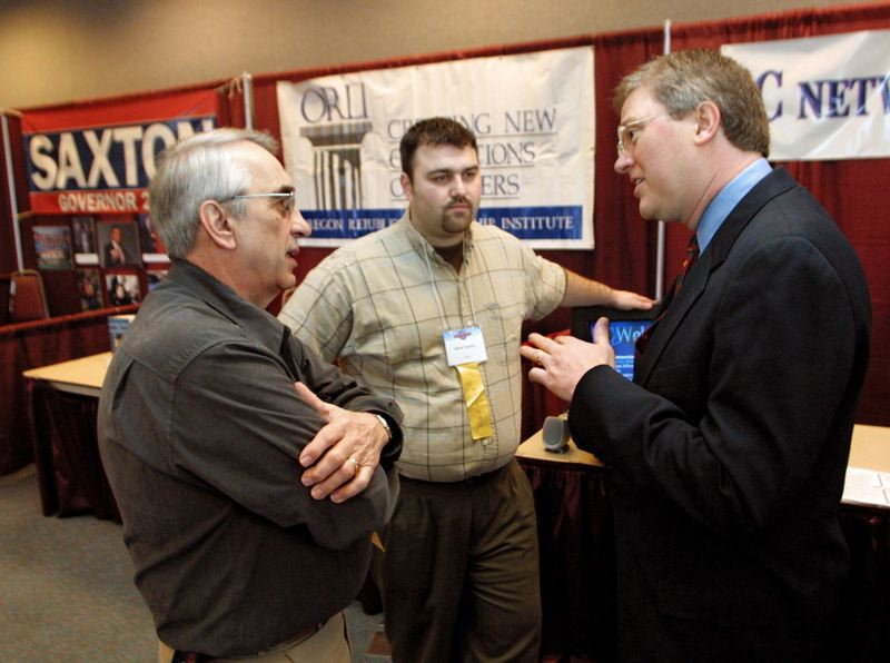 PMG FILE PHOTO: JOHN GRESS - Republican gubernatorial hopeful Ron Saxton, right, talks with Oregon Christian Coalition Executive Director Lou Beres, left, and David Tacheny, middle, during the 2001 Dorchester Conference.