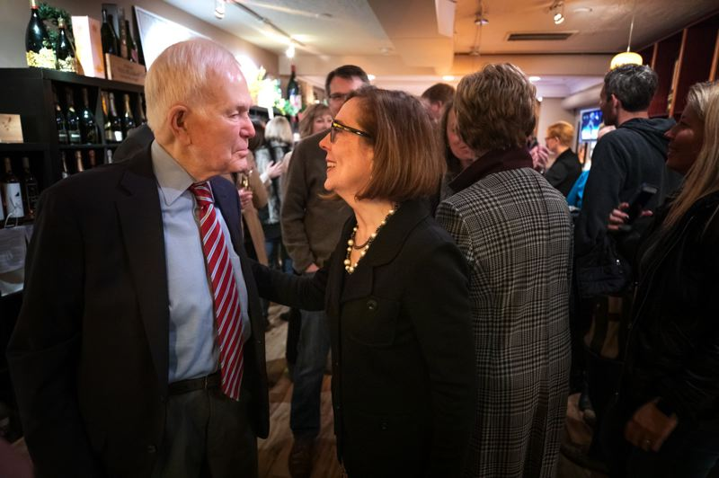 PMG PHOTO: JONATHAN HOUSE - Former U.S. Sen. Bob Packwood, talking to Gov. Kate Brown in a photo shot before the pandemic.
